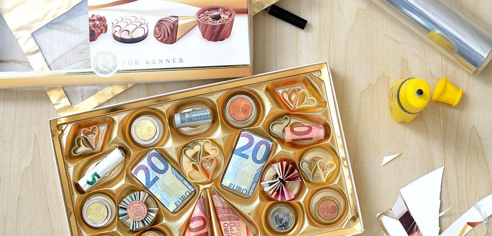 Geldgeschenk verpacken Pralinen